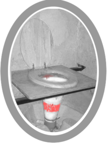 A disgusting loo make out of an upturned traffic cone